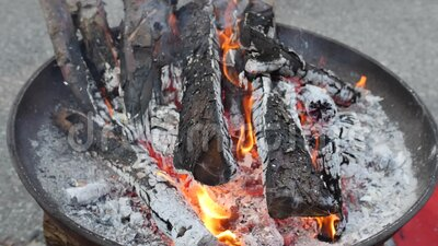Burning charcoal in a fireplace stock video footage