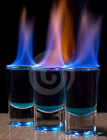 Burning drink in shot glass