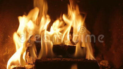 Burning Fireplace Video. Full HD video of a burning fireplace. The wooden logs are burning brightly in warm shades of yellow and orange stock footage