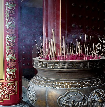 Burning Incense In Big Brass Cauldron