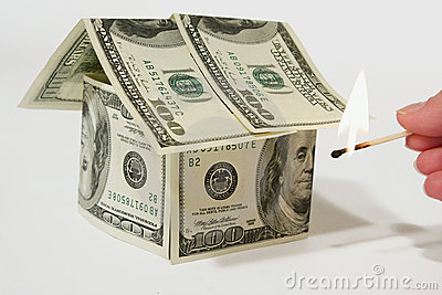 Burning money house made from dollars