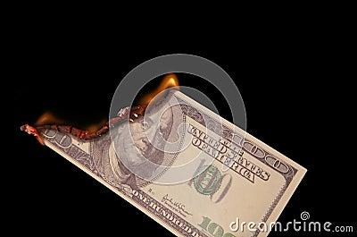 Burning one hundred dollars