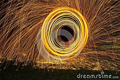Burning steel wool spin in circles to make patterns