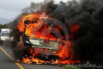Burning Van with Police car in Background