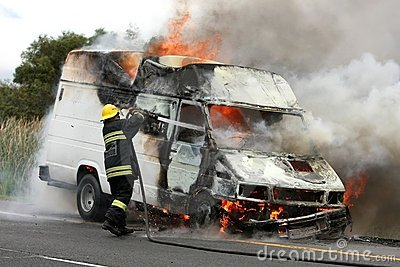 Burning Vehicle and Fireman