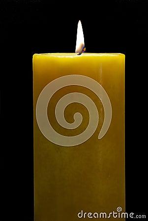 Burning Yellow Candle isolated