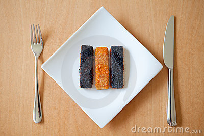 Burnt fish fingers