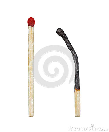Burnt match and a whole red match