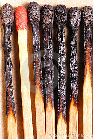 Burnt matches with red match