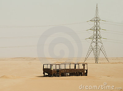 Burnt out bus and pylon near Abu Simbel, Egypt.