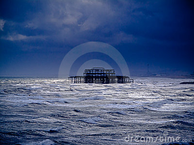 A burnt out pier in the sea