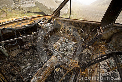 Burnt out and rusted car