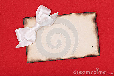 Burnt paper and white bow