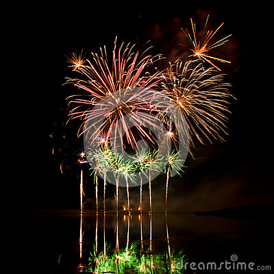 Free Bursts Of Red, Orange And Green Fireworks Stock Photos - 33229643