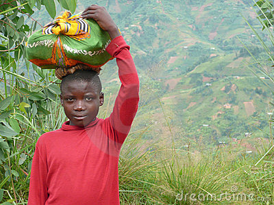 Burundi Boy with Sack on Head Editorial Image