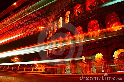 Bus light trails passing Colosseum