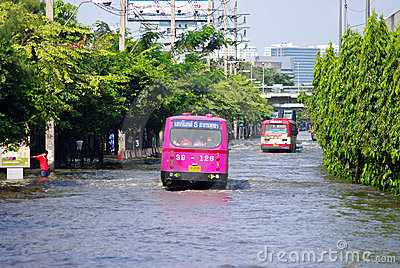 BUS ON THE ROAD WITH WATER FLOOD Editorial Photography