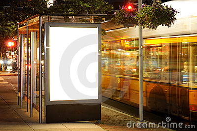 Bus Stop Billboard at Night