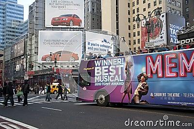 Bus tour driving through manhattan midtown Editorial Stock Image