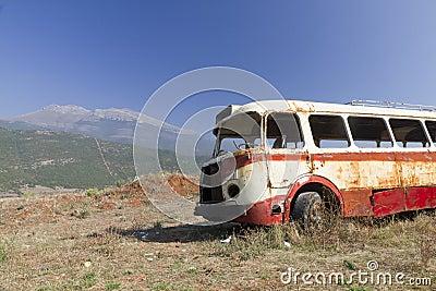 Bus wreck in arid landscape