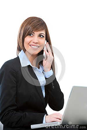 Buseness woman talking on phone with laptop.