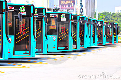 Buses in row at parking lot Editorial Stock Image