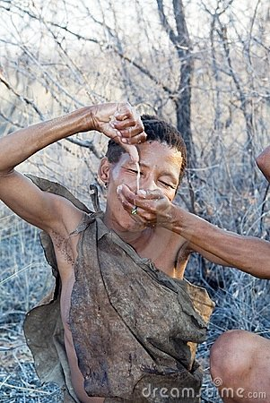 Bushmen woman is drinking the water Editorial Image