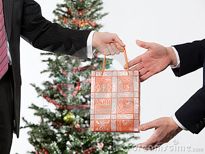 Businees man making a christmas present