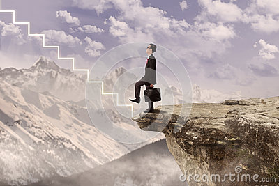 Business agent stepping on virtual stairs Stock Photo