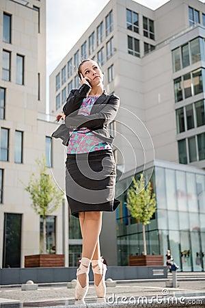 Business ballet dancer on the phone