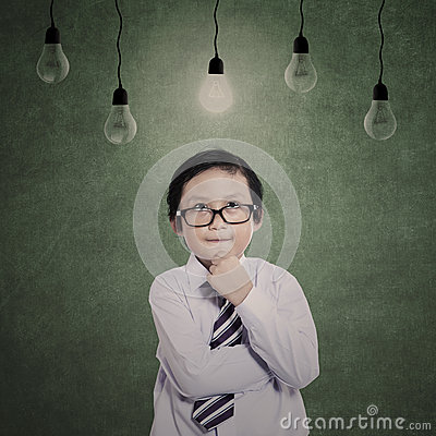 Business boy thinking under lamps