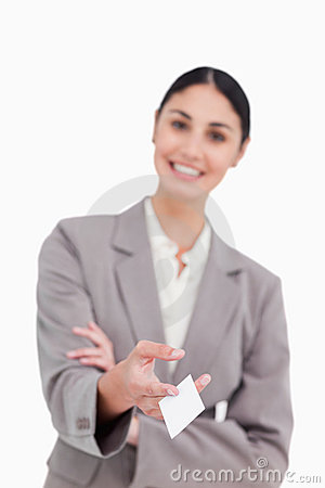 Business card being handed over by smiling saleswoman