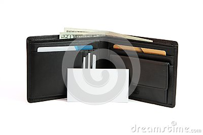 Business card in front of black wallet isolated