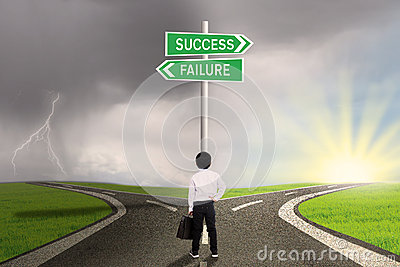 Business child  looking at sign of success or failure