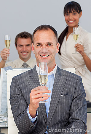 Business co-workers toasting with Champagne