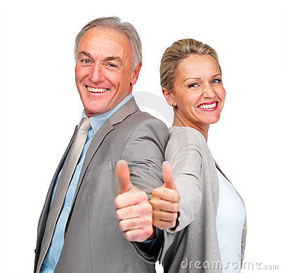 Business colleagues gesturing a success sign