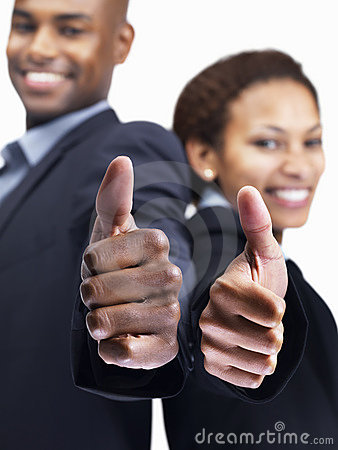 Business colleagues gesturing thumbs up sign