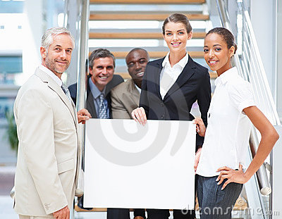 Business colleagues holding a blank bill board