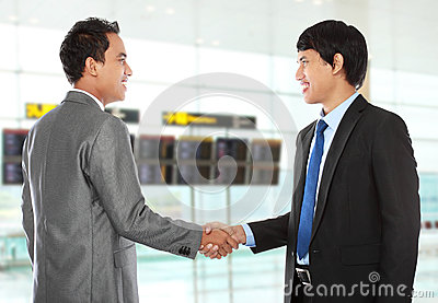 Business colleagues shaking hands