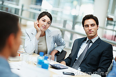 Business colleagues sitting attentively meeting