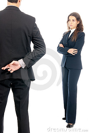 Business concept fingers crossed in front of boss
