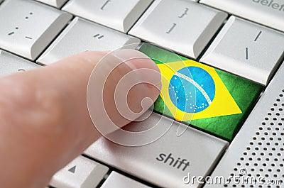 Business concept male finger pressing Brazil enter key
