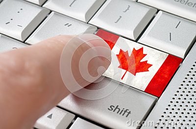 Business concept male finger pressing Canada enter key