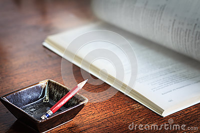 Business concept of squares cups pencil and a book on wood backg