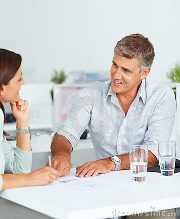 Business consultant speaking with a colleague
