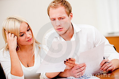 Business couple checking numbers