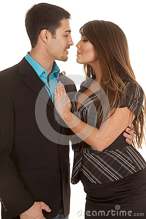 Business couple almost kissing