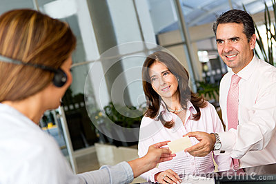 Business couple paying by credit card
