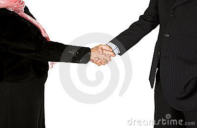 Business couple shaking hands - full bodies