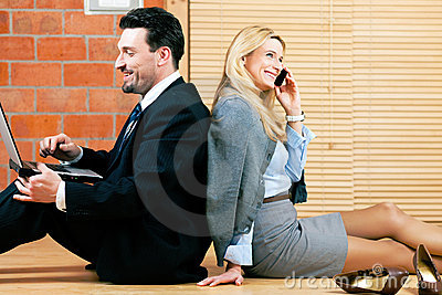 Business couple is working at home